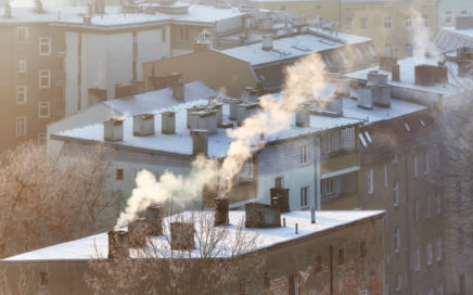 Smoking chimneys in Szczecin city at sunrise indicate burning of wood and coal in old home heating systems. Residents in many Polish cities complain of increasing health problems due to air pollution.