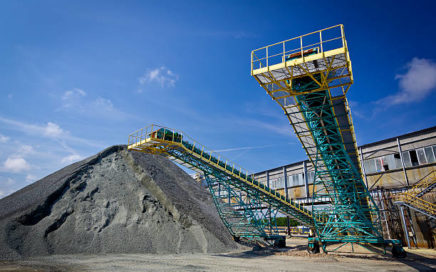 Pile of brown coal and loading equipment at the storage